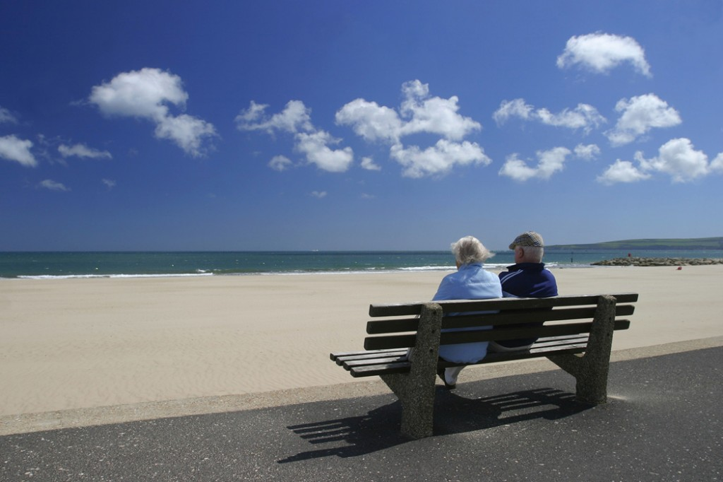 Man and woman on a bench sea-side