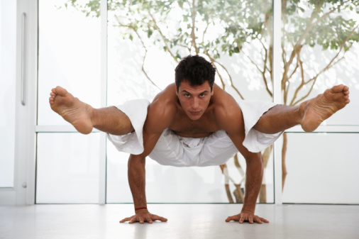 male practicing yoga