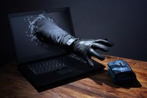 Stealing a purse through a laptop concept for computer hacker, n