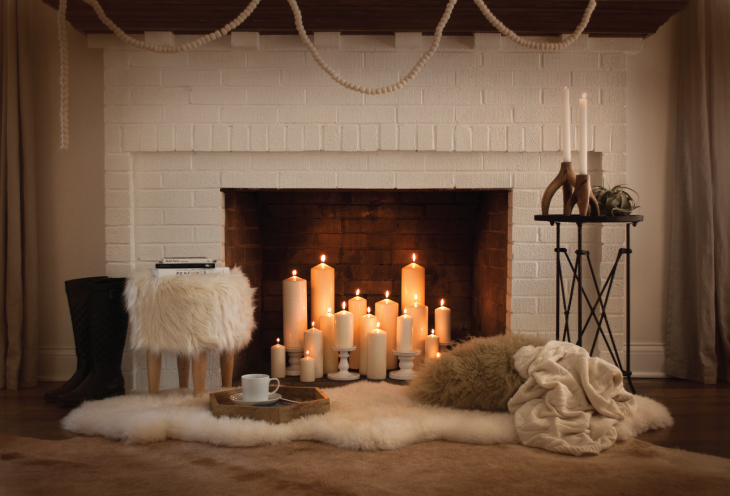 How to decorate your living room with candles - Decorate non working fireplace ...