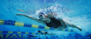 The Health Pros and Cons To Going For A Swim