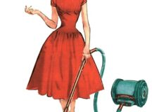 Housekeeper with a vacuum cleaner