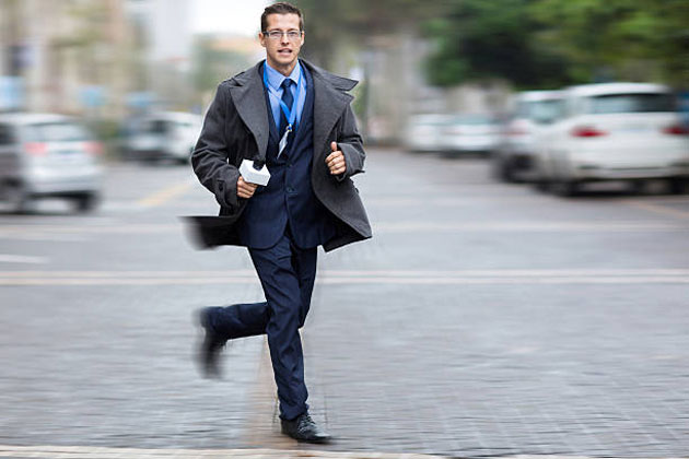 man rushing to work